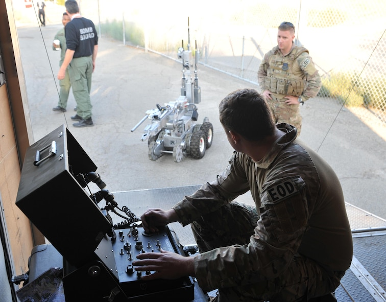 Staff Sgt. Robert Powell (front), 9th Civil Engineer Squadron explosive ordnance technician, operates a robot during Urban Shield