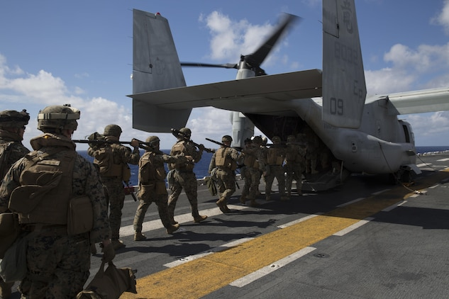 Marines with Kilo Company, Battalion Landing Team, 3rd Battalion, 5th Marines, board an MV-22B Osprey tiltrotor aircraft during Exercise Talisman Saber 2017 aboard the USS Bonhomme Richard (LHD-6) while at sea in the Pacific Ocean, July 8, 2017.