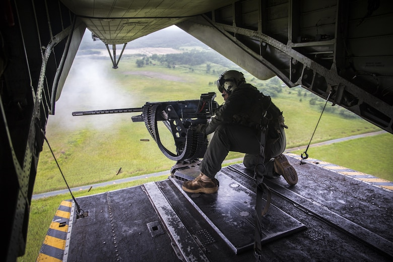 A crew chief fires a Browning M2 .50-caliber machine gun from the back of a CH-53E Super Stallion above Draughon Range near Misawa Air Base, Japan, August 21, 2017, in support of exercise Northern Viper 17. This combined-joint exercise is held to enhance regional cooperation between participating nations to collectively deter security threats. The crew chief is assigned to Marine Heavy Helicopter Squadron 462, Marine Aircraft Group 16, 3rd Marine Aircraft Wing, currently forward deployed under the Unit Deployment Program with Marine Aircraft Group 36, 1st MAW, based out of Okinawa, Japan. (U.S. Marine Corps photo by Lance Cpl. Andy Martinez)