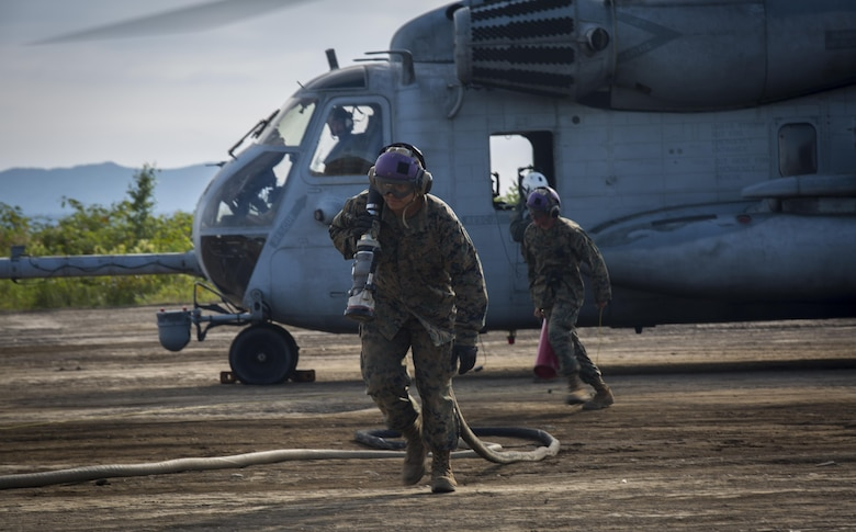 U.S. Marines refuel a CH-53E Super Stallion at a forward arming refueling point in Hokkaido, Japan, August 16, 2017, in support of Northern Viper 2017. The FARP mission is to provide fuel and ordnance necessary for aircraft to minimize response time and decrease turnaround time during operations. NV17 tests the interoperability and bilateral capability of the Japan Ground Self-Defense Force and U.S. Marine Corps forces to work together and provides the opportunity to conduct realistic training in an unfamiliar environment. The Marines are assigned to Marine Wing Support Squadron 172, Marine Aircraft Group 36, 1st Marine Aircraft Wing. (U.S. Marine Corps photo by Lance Cpl. Andy Martinez)