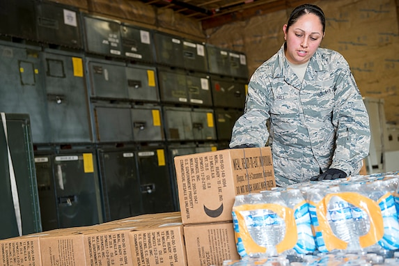 Master Sgt. Angie Hall, 434th Logistics Readiness Squadron combat readiness technician, palletizes water and meals ready to eat at Grissom Air Reserve Base, Ind., Sept. 11, 2017. The cargo is being prepared for shipment to Florida as part of Hurricane Irma relief efforts. (U.S. Air Force photo/Douglas Hays)