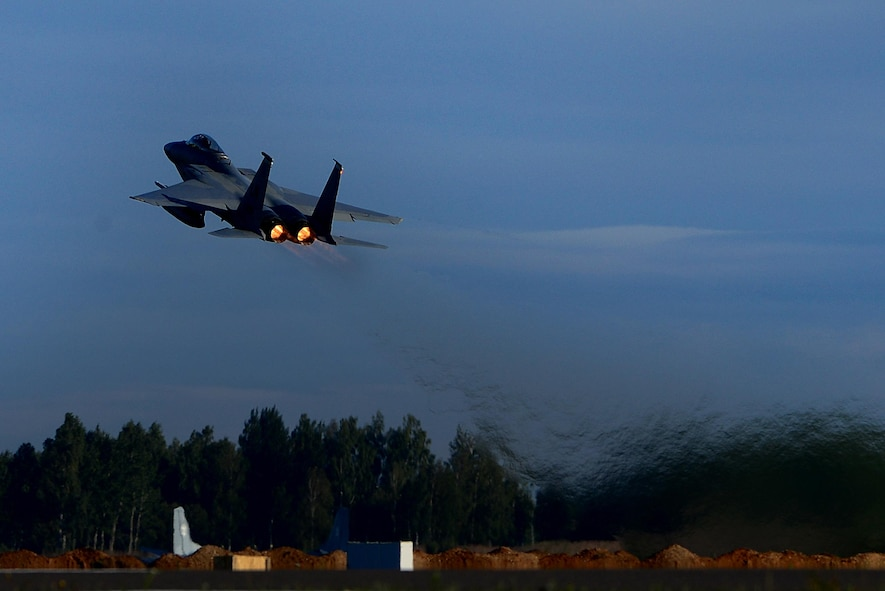 A U.S. F-15C Eagle launches for a sortie in support of the NATO Baltic Air Police mission at Siauliai Air Base, Lithuania, Sept. 8. The 493rd Expeditionary Fighter Squadron has successfully intercepted, interrogated and redirected two aircraft and conducted twenty sorties while serving to protect the skies above the Baltic region. (U.S. Air Force photo/ Tech. Sgt. Matthew Plew)