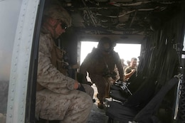 Marines with the 15th Marine Expeditionary Unit's Battalion Landing Team 1/5, practice loading into a UH-1Y Huey to conduct a Tactical Recovery of Aircraft and Personnel air familiarization drill aboard USS San Diego (LPD 22) during exercise Alligator Dagger.