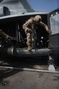 Marines with the 15th Marine Expeditionary Unit's Battalion Landing Team 1/5, exit a UH-1Y Huey during a Tactical Recovery of Aircraft and Personnel air familiarization drill aboard USS San Diego (LPD 22) during exercise Alligator Dagger.