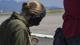 U.S. Marine Corps Cpl. Jeni Ridgell, an aircraft recovery Marine with Headquarters and Headquarters Squadron, watches a gauge on an M-31 Marine Corps Expeditionary Aircraft arresting gear during an annual certification at Marine Corps Air Station Iwakuni, Japan, Sept. 8, 2017.