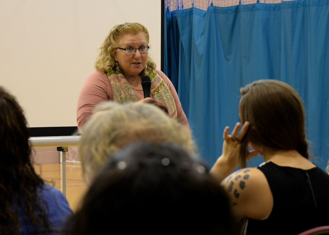 Susan Speroff, RAF Mildenhall Child Development Center Youth Program manager, greets participants of the U.K. Child and Youth Conference Sept. 9, 2017, at the Youth Center on RAF Mildenhall, England. Speroff was the key note speaker and shared with the crowd some experiences during her 36 years in education and child care. The conference offered various classes to better their abilities as child care educators and providers. (U.S. Air Force photo by Senior Airman Justine Rho)
