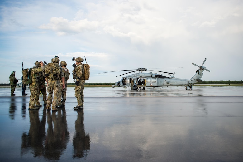 Tactical air control party specialists from the 146th Air Support Operations Squadron at Will Rogers Air National Guard Base in Oklahoma City await transportation on a U.S. Navy SH-60 Seahawk to a nearby range for an airborne controlling scenario at Camp Grayling, Mich., Aug. 6, 2017. The 146 ASOS members utilized the range to conduct close air support exercises at night while integrating with sister services. (U.S. Air National Guard photo by Senior Airman Tyler Woodward)