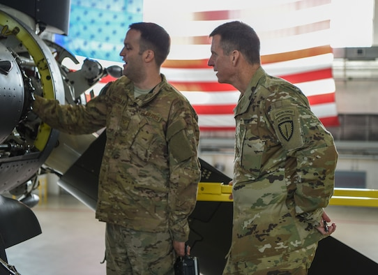 U.S. Army Maj. Gen. Mark C. Schwartz (right), commander of U.S. Special Operations Command Europe, receives a briefing from the U.S. Air Force's 352d Special Operations Maintenance Squadron during his visit to 352d Special Operations Wing on RAF Mildenhall, 7 Sept. 2017. As a part of the briefing, Schwartz observed a CV-22B Osprey during its scheduled maintenance period and received an update and readiness briefing from each squadron.