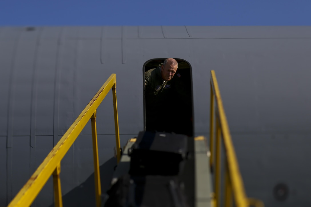 U.S. Air Force Chief Master Sgt. Michael Sylvester, 108th Operations Group Superintendent, helps to bring baggage onto a 108th Wing KC-135 Stratotanker at Joint Base McGuire-Dix-Lakehurst, N.J., Aug. 20, 2017. The 108th Wing is deploying aircraft and airmen to Andersen Air Force Base, Guam. (U.S. Air National Guard photo by Master Sgt. Matt Hecht/Released)