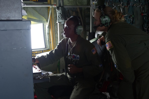 Photyo of Airmen inside a WC-130J Hurricane Hunter.