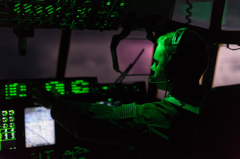 Air Force Reserve Maj. Lucas Caulder, pilot, 53rd Weather Reconnaissance Squadron, Keesler Air Force Base, Mississippi, pilots a WC-130J Super Hercules though clouds illuminated by lighting as they heads into a low-level pass though Hurricane Irma Sep. 8, 2017.