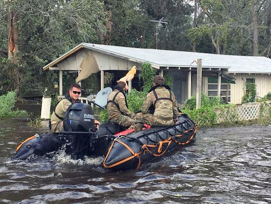 Guard searching flooded area in Fla.