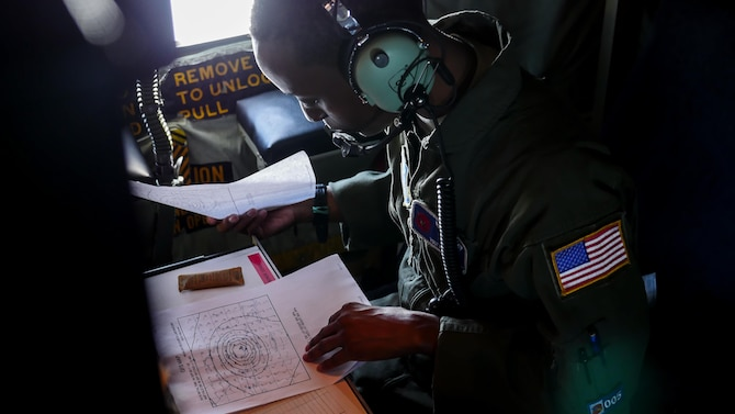 Air Force Reserve Tech. Sgt. Karen Moore, loadmaster, 53rd Weather Reconnaissance Squadron, Keesler Air Force Base, Mississippi, records weather information while flying into Hurricane Irma, Sep. 8, 2017.