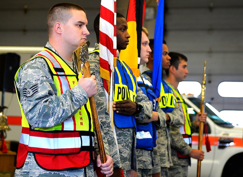 U.S. Airmen present the colors during a 9/11 retreat ceremony on Ramstein Air Base, Germany, Sept. 11, 2017. Kaiserslautern Military Community first responders conducted the ceremony to commemorate the 16th anniversary of the 9/11 attacks and to honor the first responders who lost their lives while conducting rescue operations during the event. (U.S. Air Force photo by Airman 1st Class Joshua Magbanua)