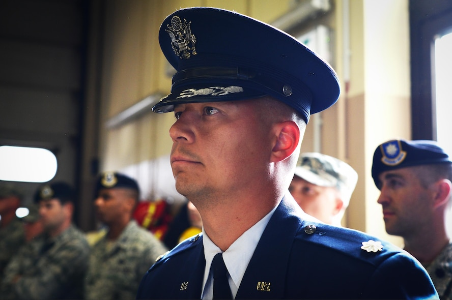U.S. Air Force Lt. Col. George Nichols, 86th Civil Engineer Squadron commander, stands at attention during a 9/11 retreat ceremony on Ramstein Air Base, Germany, Sept. 11, 2017. Kaiserslautern Military Community first responders honored their colleagues who lost their lives conducting rescue operations during the 9/11 attacks 16 years ago. (U.S. Air Force photo by Airman 1st Class Joshua Magbanua)