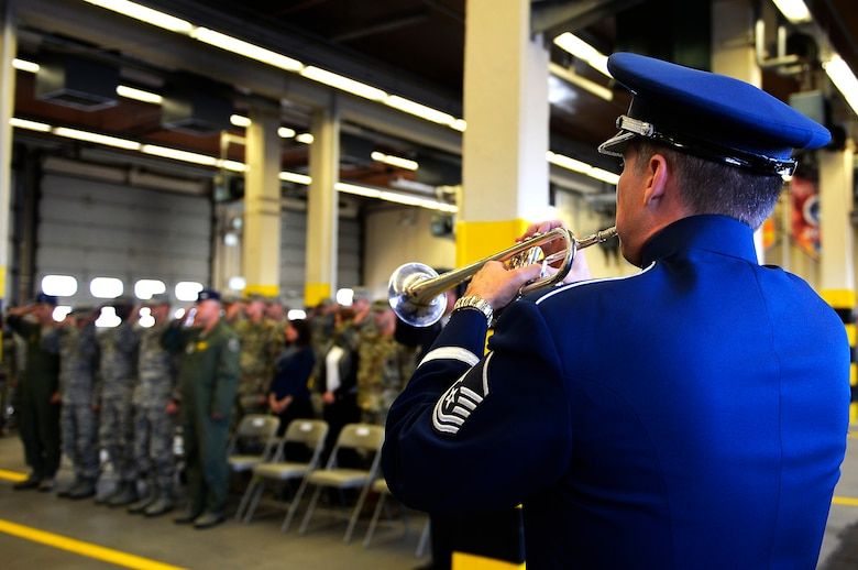 A U.S. Air Forces in Europe band member plays taps during a 9/11 retreat ceremony on Ramstein Air Base, Germany, Sept. 11, 2017. The ceremony commemorated 2,996 people who lost their lives in the attacks on the World Trade Center, the Pentagon, and the crash of United Airlines flight 93, 16 years ago. (U.S. Air Force photo by Airman 1st Class Joshua Magbanua)