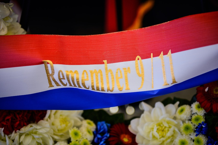 "A ribbon on a wreath displays the words ""Remember 9/11"" during a retreat ceremony on Ramstein Air Base, Germany, Sept. 11, 2017. The ceremony marked 16 years since the attacks on the World Trade Center, the Pentagon, and the hijacking of United Airlines flight 93. (U.S. Air Force photo by Airman 1st Class Joshua Magbanua)"