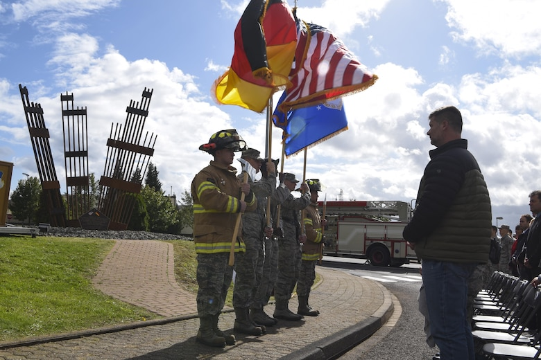 The 52nd Fighter Wing Honor Guard posts the flags of the United States, Germany and the Air Force during the 9/11 memorial ceremony at the air park on Spangdahlem Air Base, Germany, September 11, 2017. Ceremonies throughout the Air Force and around the world took place to commemorate the 16th anniversary of the attacks on 9/11. (U.S. Air Force photo by Senior Airman Dawn M. Weber)