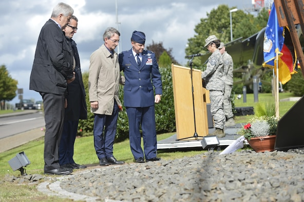 U.S. Air Force Col. Tad Clark, 52nd Fighter Wing vice commander, and prominent members of the local community place a flower arrangement at the 9/11 memorial at the air park on Spangdahlem Air Base, Germany, September 11, 2017. Ceremonies throughout the Air Force and around the world took place to commemorate the 16th anniversary of the attacks on 9/11. (U.S. Air Force photo by Tech. Sgt. Chad Warren)