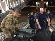 Staff Sgt. Rob Lummus, 15th Airlift Squadron loadmaster, helps medical professionals from Health and Human Services load baggage on a flight from Dulles International  Airport, Washington D.C., to Orlando, Florida, Sept. 9. The mission supported HHS as they coordinate the federal medical and public health medical support to the state of  Florida. Lummus' first exposure to a C-17 came when he was 17-years old volunteering during Hurricane Katrina.