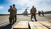 U.S. Marines with the 26th Marine Expeditionary Unit, deliver food and water by way of UH-1Y Venom helicopters to St. Thomas Cyril King E. Airport, U.S. Virgin Islands in order to aid victims of Hurricane Irma in the U.S. Virgin Islands, Sept. 10, 2017.