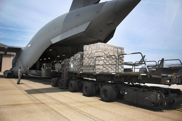 Airmen from the 87th Aerial Port Squadron load cargo onto a 445th Airlift Wing C-17 Globemaster III headed for Homestead Air Reserve Base, Florida Monday. Cargo included a pallet of meals ready to eat, a pallet of water and one ISU 90 loaded with cots. (U.S. Air Force photo/Master Sgt. Patrick O'Reilly)