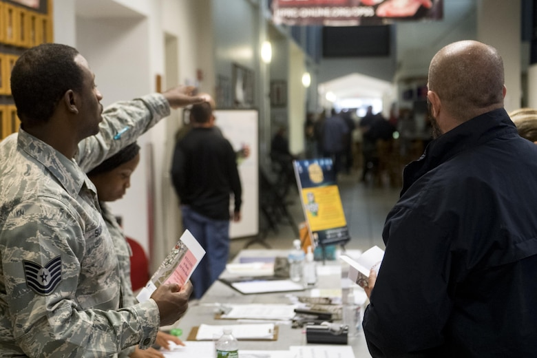 U.S. Air Force Tech. Sgt. Gerrod Suber, 23d Force Support Squadron personnel specialist, directs members from various federal law enforcement agencies through in-processing procedures, Sept. 10, 2017, at Moody Air Force Base, Ga. Moody Air Force Base hosted approximately 400 members from 14 different federal agencies who will deploy to conduct security or search and rescue missions in areas effected by Hurricane Irma. (U.S. Air Force photo by Airman 1st Class Daniel Snider)