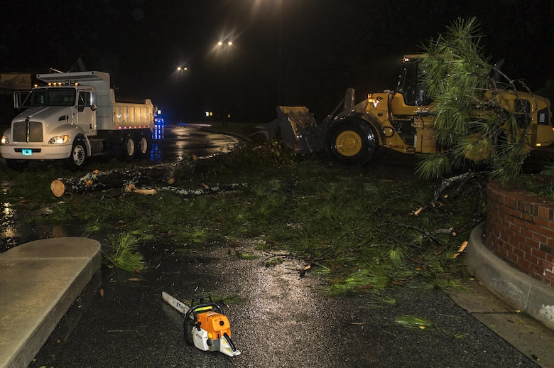 23rd Civil Engineer Squadron heavy equipment operators clear a fallen tree from in front of the Davidson Road Gate, Sept. 11, 2017, at Moody Air Force Base, Ga. Moody's ride-out team consisted of approximately 80 Airmen who were tasked with immediately responding to mission-inhibiting damage caused by Hurricane Irma. (U.S. Air Force photo by Airman 1st Class Daniel Snider)