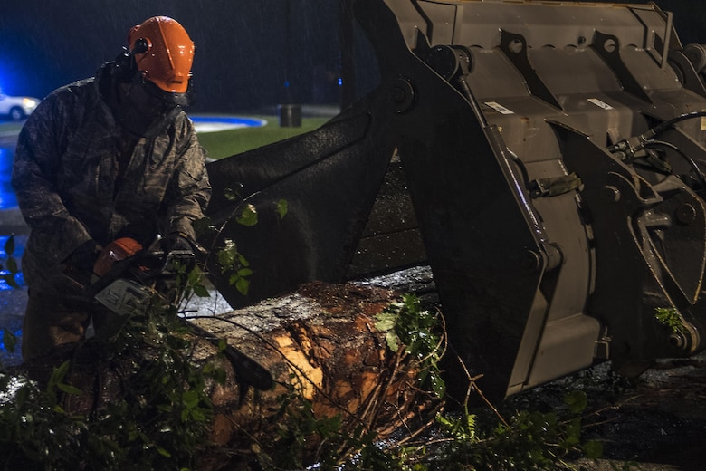 Senior Airman Justin Benito, 23rd Civil Engineer Squadron heavy equipment operator, uses a chainsaw to cut a fallen tree's trunk, Sept. 11, 2017, at Moody Air Force Base, Ga. Moody's ride-out team consisted of approximately 80 Airmen who were tasked with immediately responding to mission-inhibiting damage caused by Hurricane Irma. (U.S. Air Force photo by Airman 1st Class Daniel Snider)