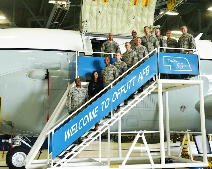 Chief Master Sgt. of the Air Force Kaleth O. Wright and his wife, Tonya Wright, pose for a photo in front of an RC-135 Rivet Joint reconnaissance aircraft with some Team Offutt members inside the Bennie Davis Maintenance Facility on Offutt Air Force Base, Nebraska, Aug. 31, 2017.