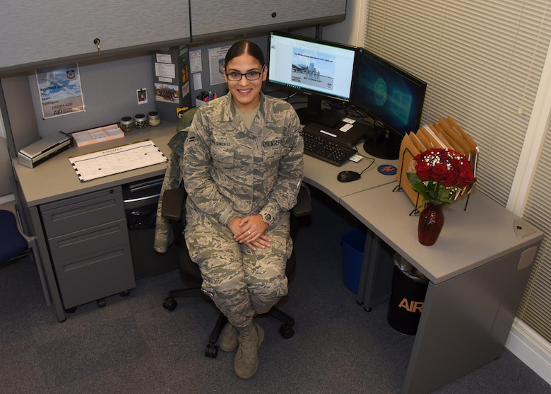 Airman 1st Class Natalie Nieves-Gonzalez poses for a photo at her desk in the retention office Aug. 31, 2017 at Warfield Air National Guard Base, Middle River, Md. Nieves-Gonzalez has worked as the recruiting and retention administrator for about a year. (U.S Air National Guard photo by Senior Airman Enjoli Saunders)