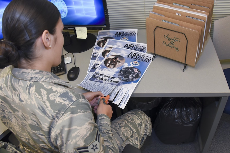 Airman 1st Class Natalie Nieves-Gonzalez prepares information to be distributed for recruiting event Aug. 31, 2017 at Warfield Air National Guard Base, Middle River, Md. Nieves-Gonzalez has worked as the recruiting and retention administrator for about a year. (U.S Air National Guard photo by Senior Airman Enjoli Saunders)