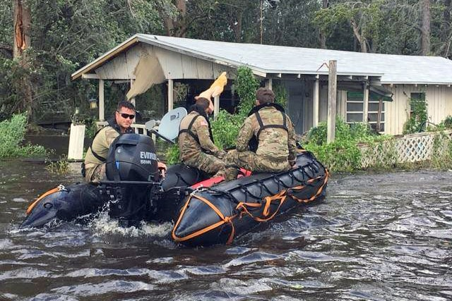 Soldiers use a boat to conduct search and rescue missions.