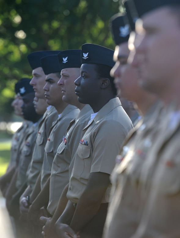 Members of the Center for Naval Aviation Technical Training Unit Keesler stand in formation during a 9/11 memorial ceremony hosted by the CNATTU Keesler in front of Alho Manor Sept. 11, 2017, on Keesler Air Force Base, Mississippi. The event honored those who lost their lives during the 9/11 attacks. (U.S. Air Force photo by Kemberly Groue)