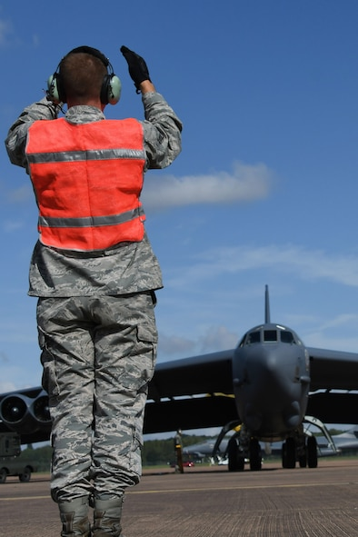 A B-52 Stratofortress is marshalled into place at Royal Air Force Fairford, U.K., Sep. 1, 2017.