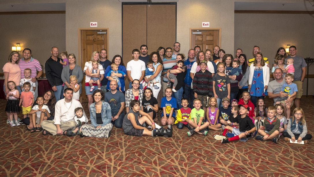 "Families from the 126th Air Refueling Squadron, 182nd Airlift Wing and 183rd Wing pose for a photo during the Strong Bonds ""The 7 Habits of Highly Effective Families"" program in Lake Geneva, Wis., Aug. 25, 2017. The 14 Illinois Air National Guard families spent the weekend with chaplains learning how build resiliency through strengthening family relationships. (U.S. Air National Guard photo by Tech. Sgt. Lealan Buehrer)"