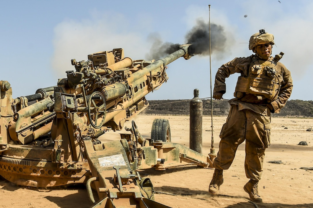 A Marine fires a howitzer during training.