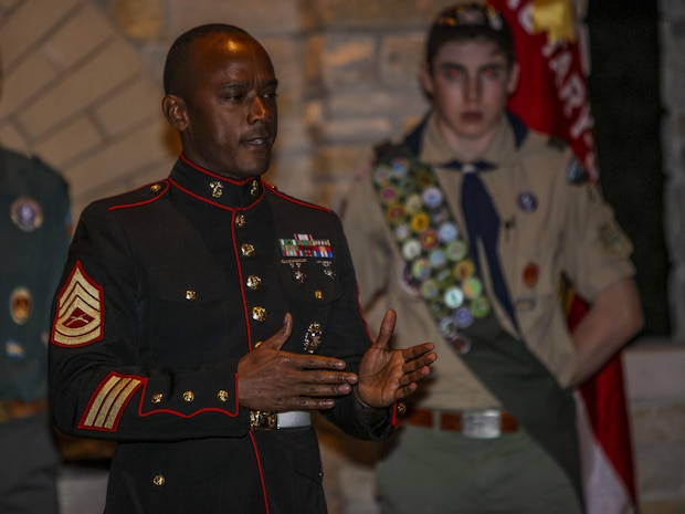 Gunnery Sgt. Robert Catching, a St. Louis, Missouri, native and a recruiter from Recruiting Station Chicago, talks to boy scouts from Troop 55 during the 2017 Fall Court of Honor ceremony in Glenview, Illinois, Sept 11.  He spoke to the Boy Scouts about the pride of wearing the Marine Corps uniform. (U.S. Marine Corps photo by Lance Cpl. Quavaungh Pointer/Released)