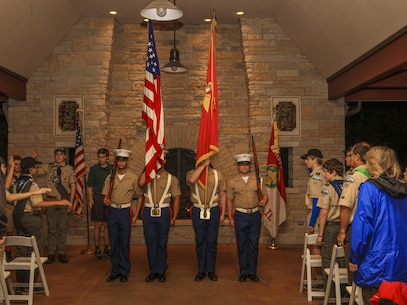 A Marine Corps color guard with Recruiting Station Chicago participates in delivers the colors before kicking off the Troop 55 2017 Fall Court of Honor ceremony in Glenview, Illinois, Sept 11. Gunnery Sgt. Robert Catching, a recruiter with RS Chicago, spoke about the pride of wearing the Marine Corps uniform. (U.S. Marine Corps photo by Lance Cpl. Quavaungh Pointer/Released)
