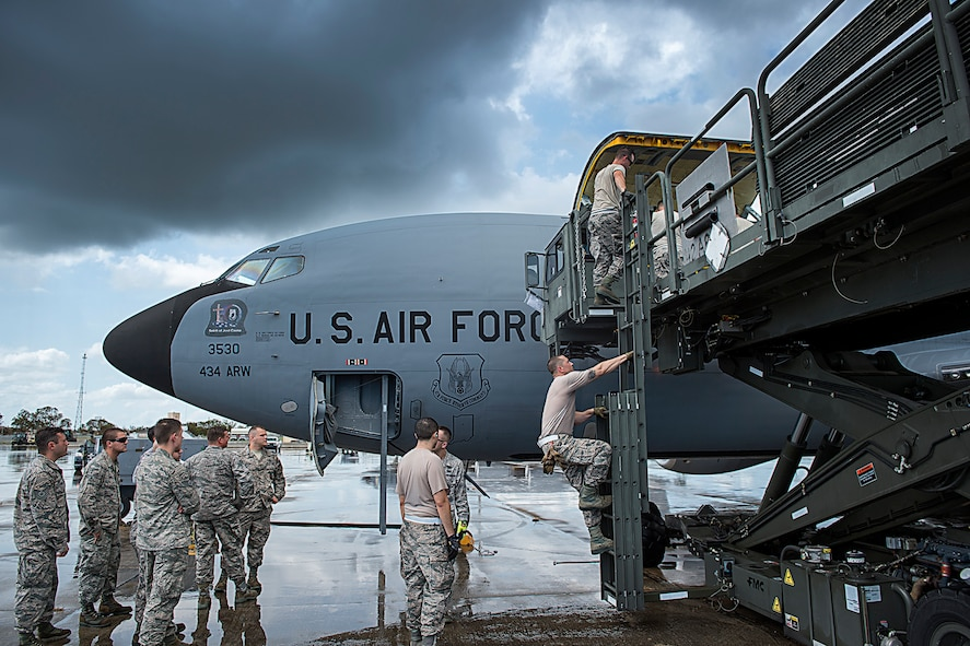 Firefighters from the 434th Air Refueling Wing unload their gear from a KC-135R Stratotanker at Homestead Air Reserve Base, Fla., Sept. 12, 2017. As soon as they were able to grab their gear the airfield could open to support heavy aircraft and further recovery efforts. (U.S. Air Force photo/Tech. Sgt. Benjamin Mota)