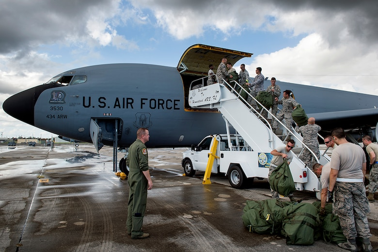 Men and women from the 434th Air Refueling Wing offload baggage and cargo upon arrival to Homestead Air Reserve Base, Fla., Sept. 12, 2017. Airmen from the Hoosier Wing deployed to Homestead to assist with Hurricane Irma recovery efforts. (U.S. Air Force photo/Tech. Sgt. Benjamin Mota)