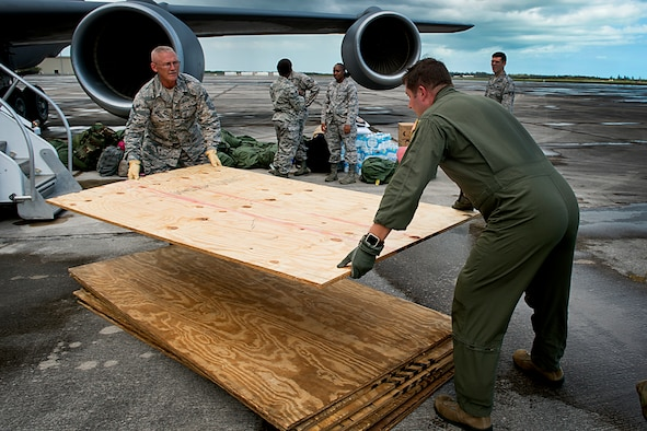 Senior Master Sgt. Tim Woods, left, and Maj. Matt O'Neil, citizen Airmen from the 434th Air Refueling Wing unload plywood at Homestead Air Reserve Base, Fla., Sept. 12, 2017. Airmen from the Hoosier Wing deployed to Homestead to assist with Hurricane Irma recovery efforts. (U.S. Air Force photo/Tech. Sgt. Benjamin Mota)