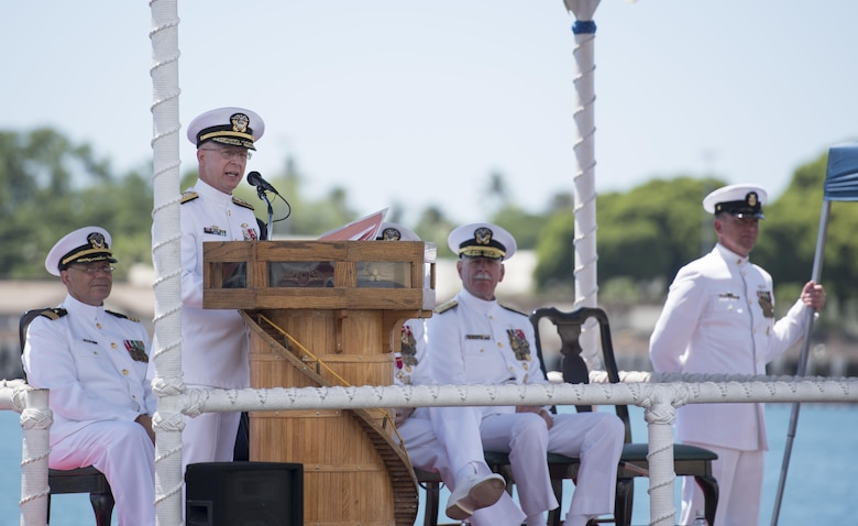 Rear Adm. Daryl L. Caudle, commander, Submarine Force, U.S. Pacific Fleet (COMSUBPAC), addresses guests during the COMSUBPAC change of command ceremony aboard the Los Angeles-class fast attack submarine USS Jacksonville (SSN 699).