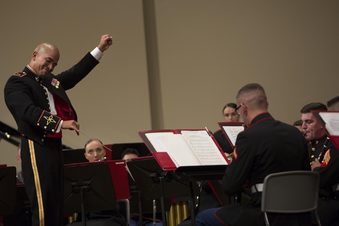 Chief Warrant Officer Andres Navarro conducts the III Marine Expeditionary Force Band during the 22nd Annual Combined Band Concert Sept. 9 at the Ginowan Civic Hall in Ginowan City, Okinawa, Japan.
