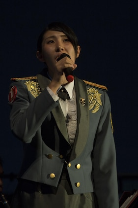 Leading Pvt. Kana Nakazawa sings during the 22nd Annual Combined Band Concert Sept. 9 at the Ginowan Civic Hall in Ginowan City, Okinawa, Japan.