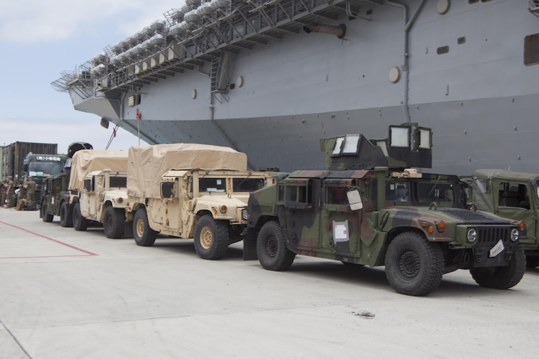 Humvees belonging to the 31st Marine Expeditionary Unit sit pier side at White Beach Naval Facility, Okinawa, Japan, June 7, 2017.