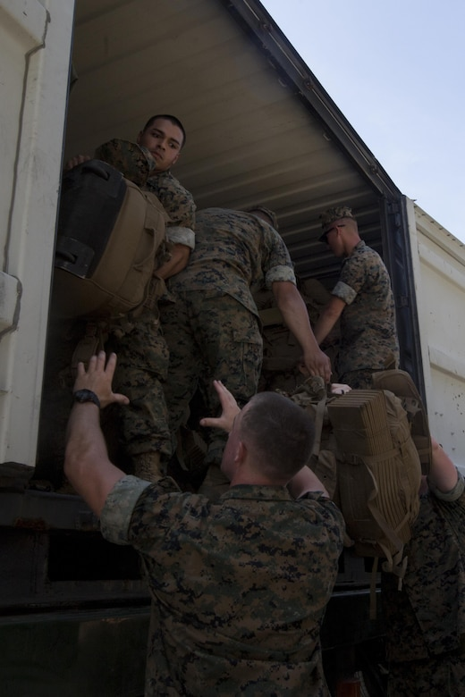 Marines with the 31st Marine Expeditionary Unit move sea bags, packs and gear pier side at White Beach Naval Facility, Okinawa, Japan, June 7, 2017.