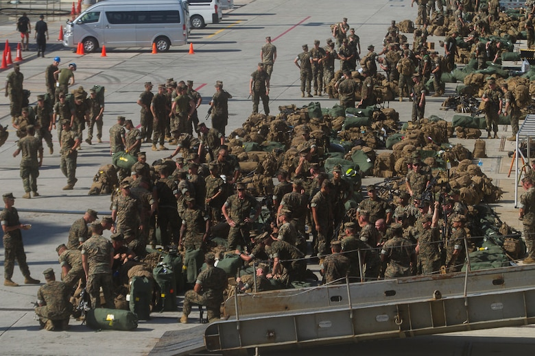 A mass of Marines, packs, sea bags and weapons sit pier side alongside the USS Bonhomme Richard (LHD 6) as the Marines and Sailors of the 31st Marine Expeditionary Unit embark aboard the BHR for a scheduled patrol of the Indo-Asia-Pacific region, June 7, 2017.