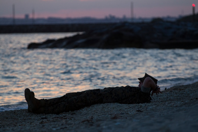 Petty Officer 3rd Class Matthew Robinson, a corpsman with Combat Logistics Battalion 31, enjoys a final sunset before departing from Okinawa, Japan, as part of the 31st Marine Expeditionary Unit, June 7, 2017.