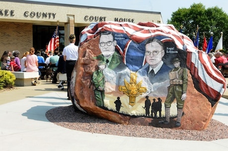 """This rock was painted and dedicated at Cherokee, Iowa during a ceremony that was part of the Freedom Rock Tour, September 10, 2017. The rock honors the service members past and present from Cherokee County, Iowa, and was painted by Ray """"Bubba"""" Sorensen II as a tribute. This rock is part of a collective effort to place a Freedom Rock in each of Iowa's 99 counties. During the ceremony, Cherokee County native, and Commanding General of the 88th Regional Support Command, Maj. Gen. Patrick Reinert spoke about his service and the honor he has of being a veteran from Cherokee County."""